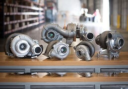 Diesel Engine Turbochargers Sitting on a Polished Table